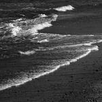 Enrolando na areia