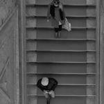 Steps down.