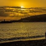 O pescador e o por do sol.