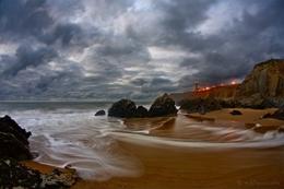 O mar enrola n'areia___